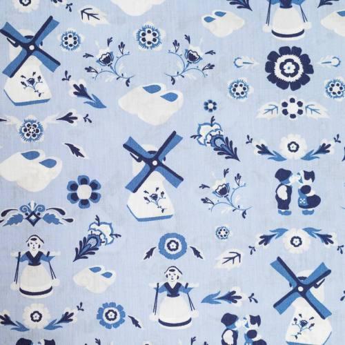 Popeline de coton bleue motif folklore