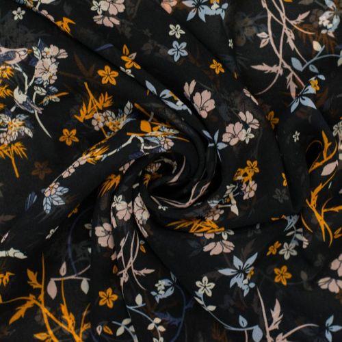 Mousseline noire motif fleurs pastel et orange