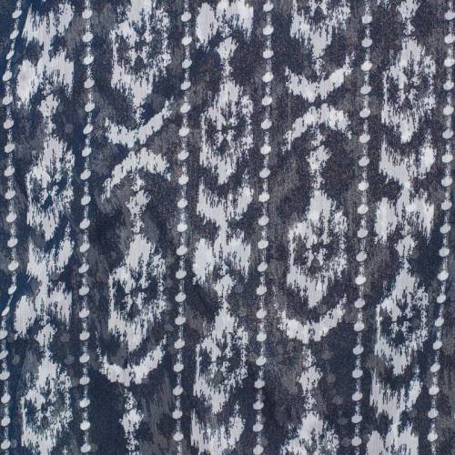Mousseline bleu marine pailletée motif Micronésie blanc