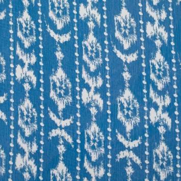 Mousseline bleue pailletée motif Micronésie écru