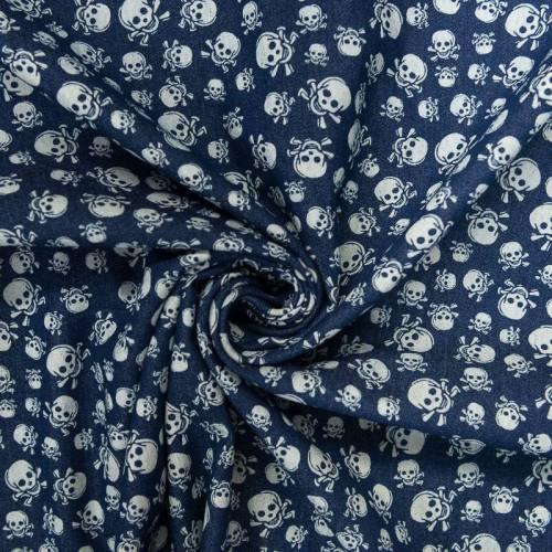 Tissu jean bleu foncé motif tête de mort