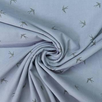 Velours côtelé bleu ciel motif hirondelles pailletées
