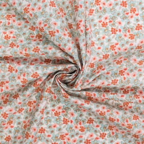 Coton blanc motif lilas bleu et rose