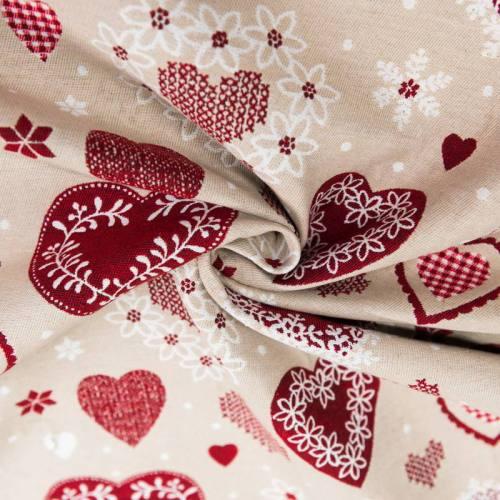 Jacquard beige motif coeur de chalet rouge