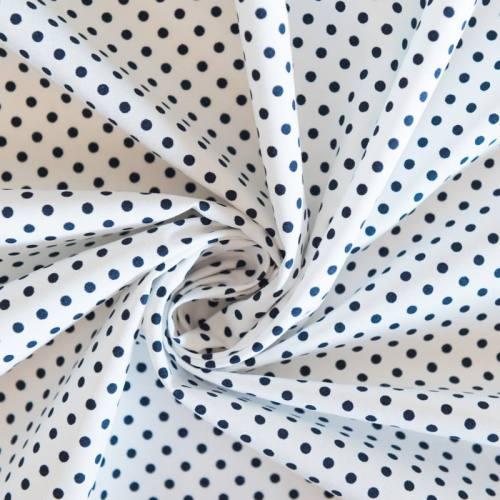 Coton blanc motif petit pois bleu marine