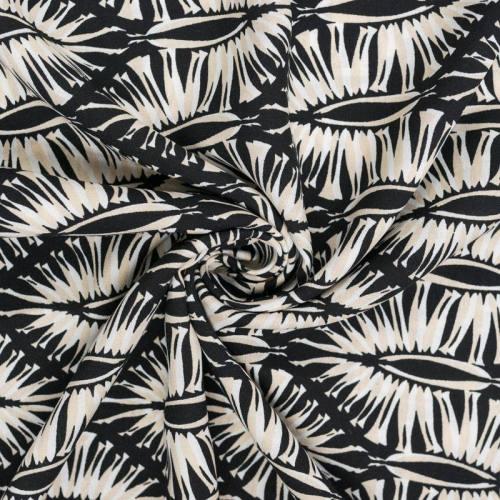 Tissu viscose noir motif formes géométriques végétales écrues et beiges
