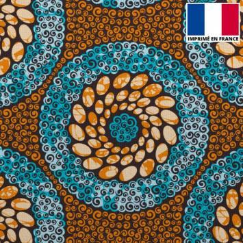 Velours ras imprimé wax spirale orange et bleue