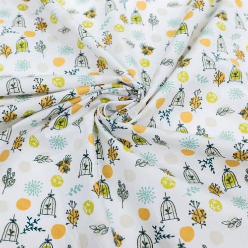 Coton blanc motif branche et cage à oiseau vert et safran