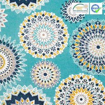Coton enduit bleu lagon motif manija ocre