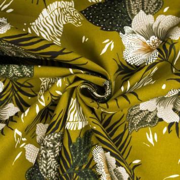 Toile coton kaki clair motif feuille tropicale et zèbre