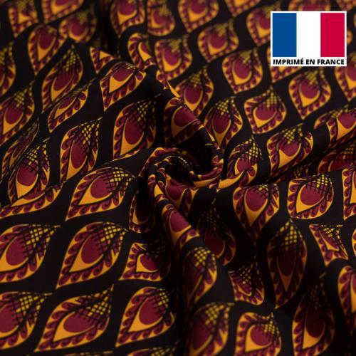 Satin noir imprimé wax pétale rouge et jaune tp1