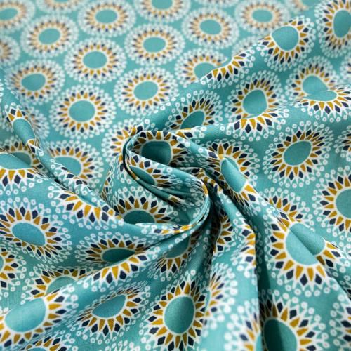 Coton enduit bleu lagon motif acqua ocre