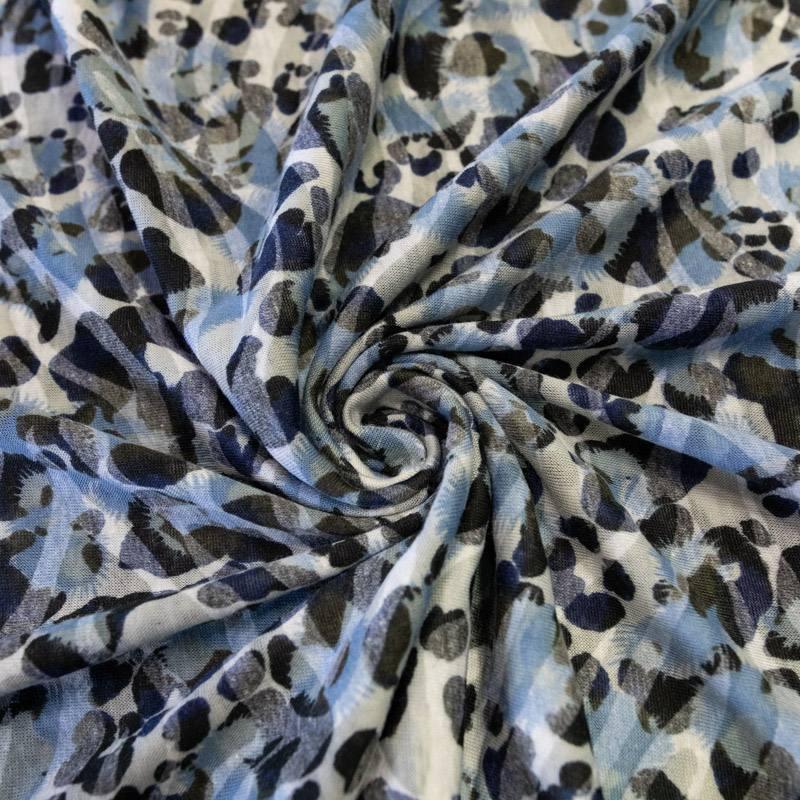 Jersey léger écru effet léopard bleu