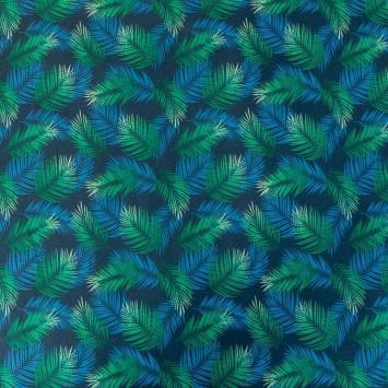 Coton enduit bleu marine motif feuilles tropicales bleues et vertes