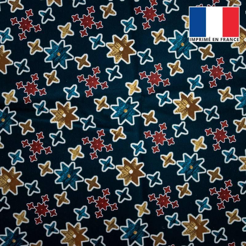 Velours ras bleu foncé motif étoile géométrique jaune et rouge