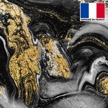 Lycra imprimé magma noir et écru et poudre d'or