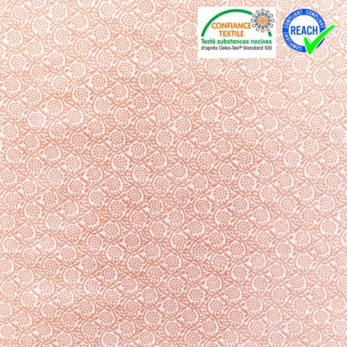 Coton blanc motif fleur saumon