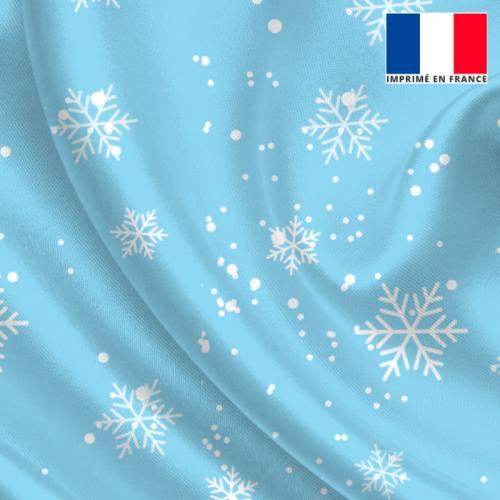 Tissu satiné bleu clair imprimé flocon de neige
