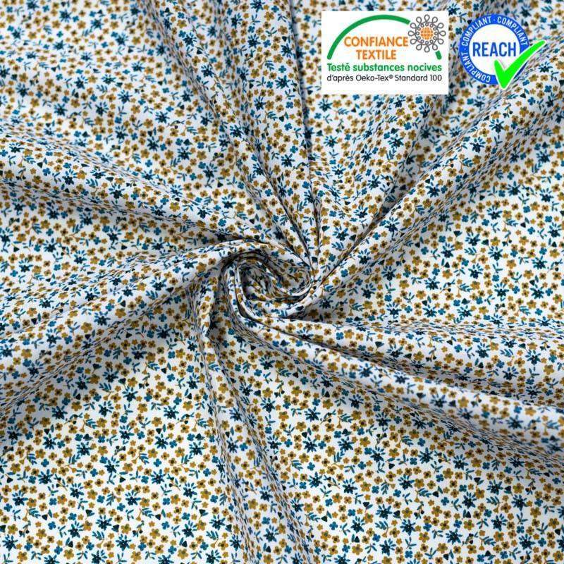 Coton blanc motif petites fleurs bleues et ocre pio