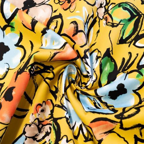 Satin de coton extensible jaune motif fleur bleue et marron