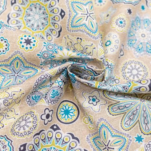 Coton enduit beige motif fleur verte et bleue
