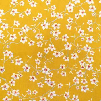 Coton jaune safran motif fleur d'amandier blanche