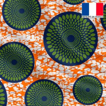 Lycra orange imprimé wax rosace bleue à pois verts
