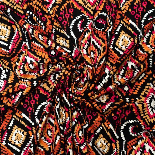 Jersey viscose noir motif géométrique abstrait ocre orange et rose