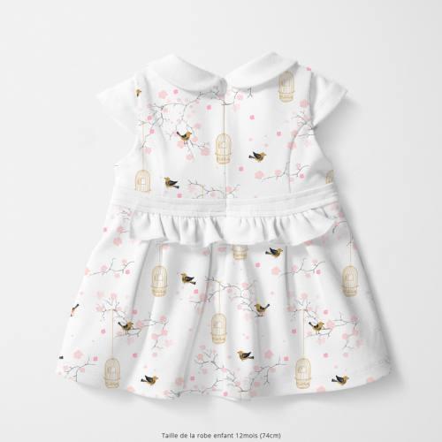 Coton blanc motif fleur de cerisier et cage à oiseaux Oeko-tex
