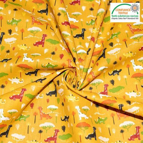 Popeline de coton ocre motif dinosaure jurassic Oeko-tex