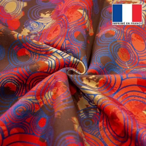 Rond bleu et tâche rouge - Fond marron
