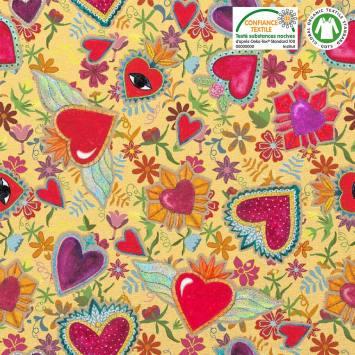 Coton bio safran motif multi-fleurs et coeurs rouges Oeko-tex