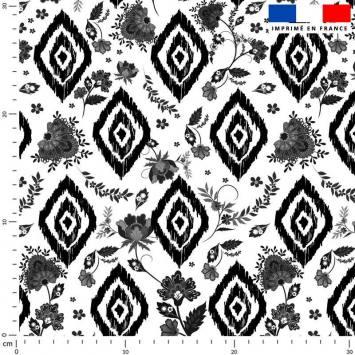 Tissu caban twill écru imprimé ethnique à petites fleurs noires