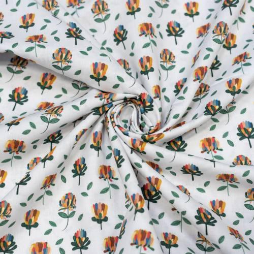 Coton bio blanc motif fleur aux pétales multicolores Oeko-tex