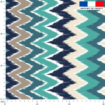 Tissu imperméable bleu motif chevron vert et grège