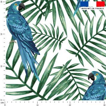 Tissu imperméable vert motif perroquet bleu et feuille tropicale