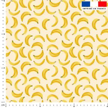 Banane - fond jaune pastel