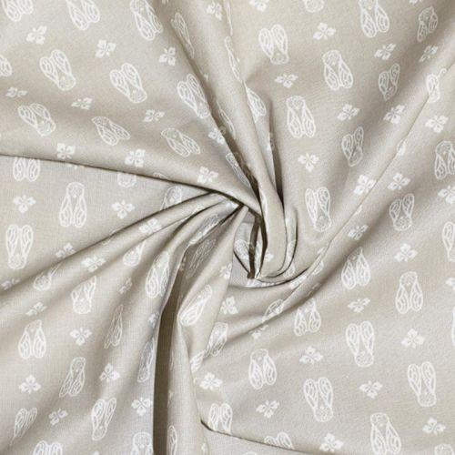 Coton enduit beige motif cigale blanche Oeko-tex