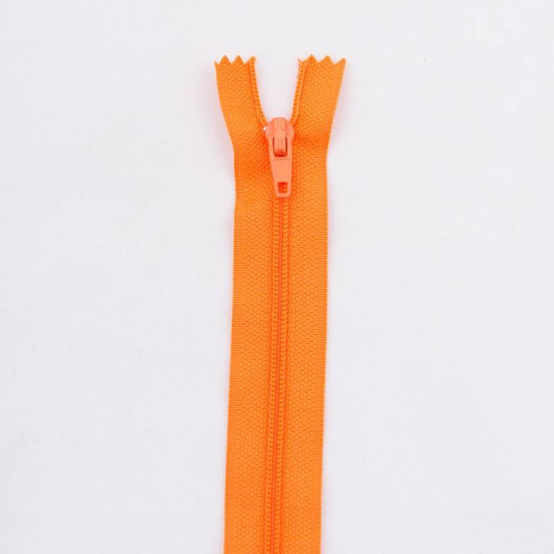 Fermeture 20 cm polyester non séparable orange Col 120