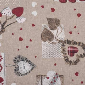 Coton enduit motifs cœurs rouges