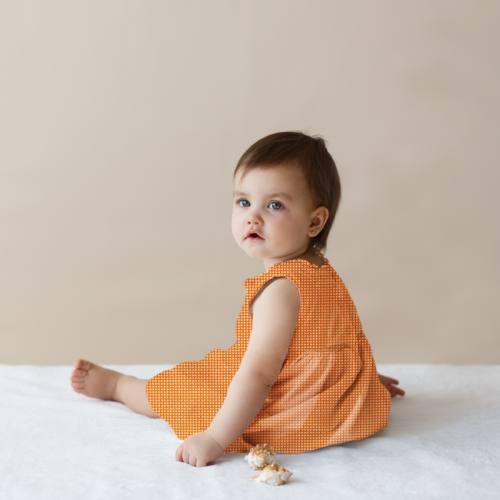 Coton orange motif noeud papillon géométrique